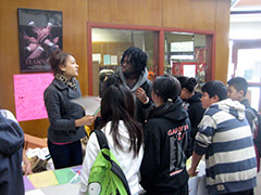 Photo of students seeking guidance from a school counselor